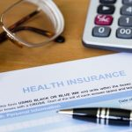 health-insurance-documents-desk