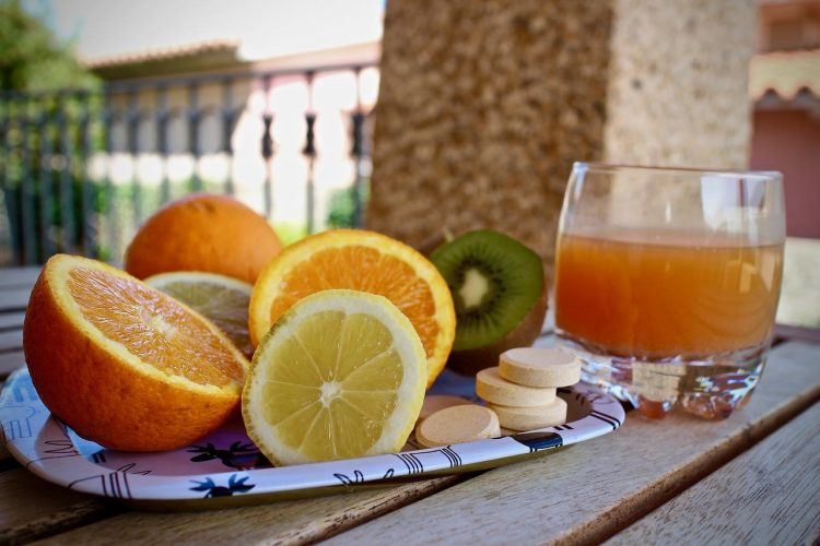 Citrus fruit, orange juice, and Vitamin C supplement