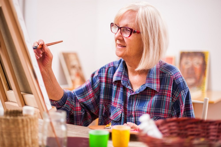 painting happy old senior